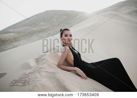 Fashion asian woman model in luxury dress in desert
