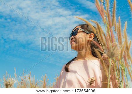 Girl And Feather Pennisetum