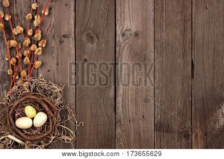 Spring Nest Side Border With Willow Branches Over A Rustic Wooden Background