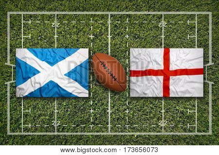 Scotland vs. England flags on green rugby field, 3 D illustration