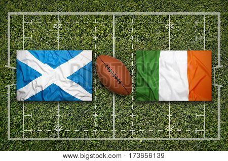 Scotland vs. Ireland flags on green rugby field, 3 D illustration