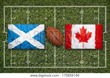 Scotland vs. Canada flags on green rugby field, 3 D illustration