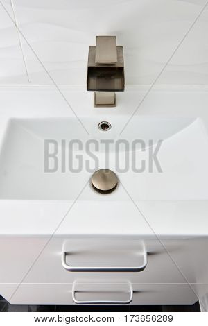 White modern design bathroom vanity with white marble sink and brushed nickel  waterfall faucet
