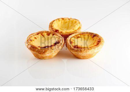 3 tasty Portugese Custard Tarts with reflection isolated on white background