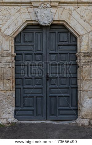 Front Door to Old Spanish Mission through stone wall