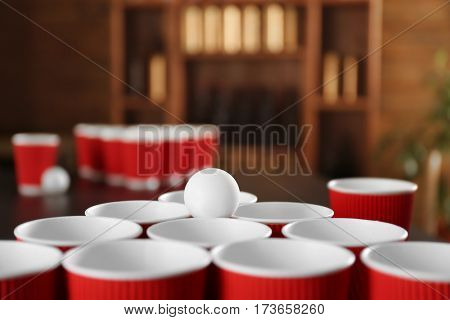 Cups for game Beer Pong on table, closeup