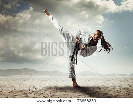 Karate sport girl kick in outdoor. Concept