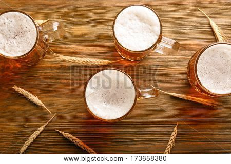 Glasses with beer on wooden background