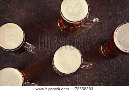 Glasses with beer on dark background