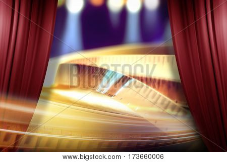 film award on the spotlight background behind of open red curtain