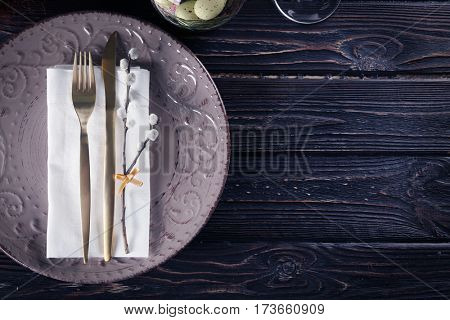 Beautiful table setting with Easter decor on wooden background