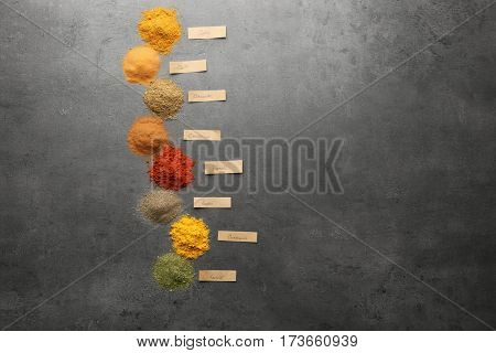 Heaps of various powder spices on table