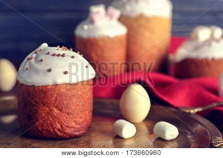 Tasty Easter cake with decorations on tray