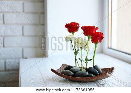 Flower arrangement on windowsill