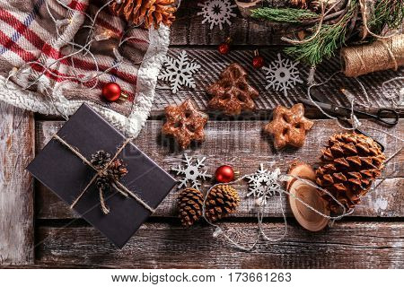 Gift box and Christmas decorations on wooden background