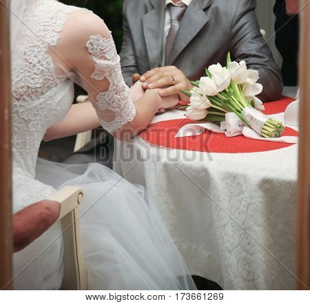 Newlyweds sitting at table