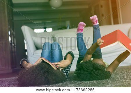 Little Girls Lay On The Floor Reading Book Sisterhood