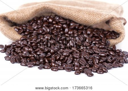 Coffee Beans In Burlap Sack Isolated On White