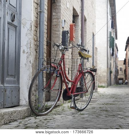 Urbania, Italy - August, 1, 2016: bicycle on a street in an ancient part of Urbania, Italy