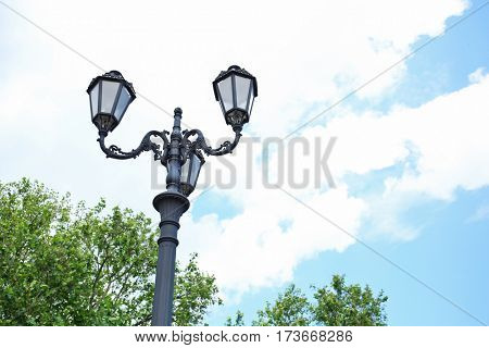 Street lamps on the sky background