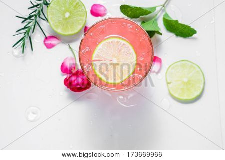 Refreshing summer drink with fruit punch in glasses