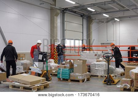 ST. PETERSBURG, RUSSIA - OCTOBER 27, 2016: Workers in the warehouse of Ulmart company during the press tour. Ulmart is one of the largest Internet retailers in Russia