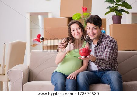 Young couple saving money for baby to be born