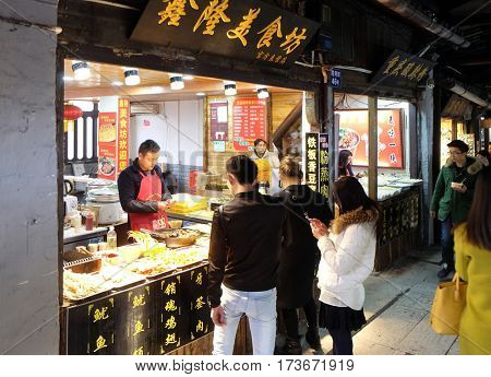 XITANG - FEBRUARY 20: Chinese exotic food in street food market in water village Xitang, located in Zhejiang Province, China, February 20, 2016.
