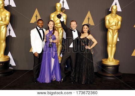 David Oyelowo, Joanna Natasegara, Orlando von Einsiedel and Salma Hayek at the 89th Annual Academy Awards - Press Room held at the Hollywood and Highland Center in Hollywood, USA on February 26, 2017.