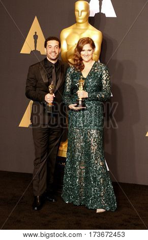 Caroline Waterlow and Ezra Edelman at the 89th Annual Academy Awards - Press Room held at the Hollywood and Highland Center in Hollywood, USA on February 26, 2017.