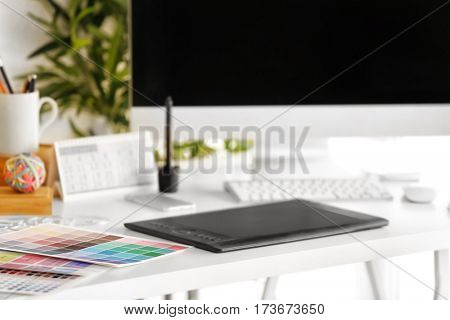 Modern workplace of designer with modern devices