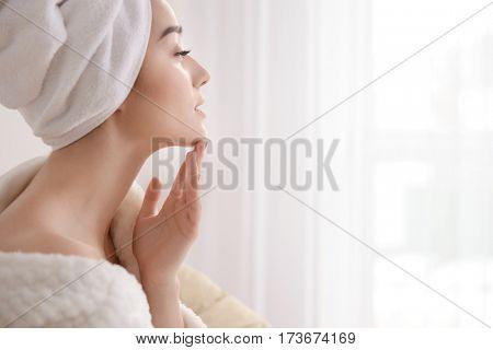 Beautiful young woman in spa salon