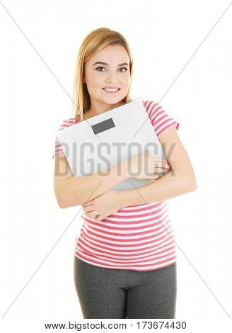 Beautiful pregnant woman holding scales on white background