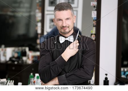 Stylish professional barber at workplace