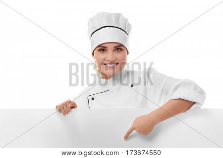 Young woman chef holding white blank banner isolated on white background