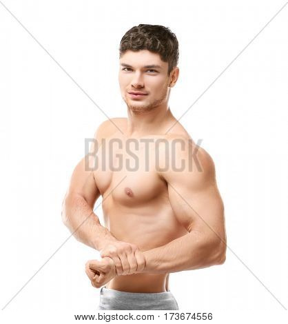 Handsome sporty man on white background