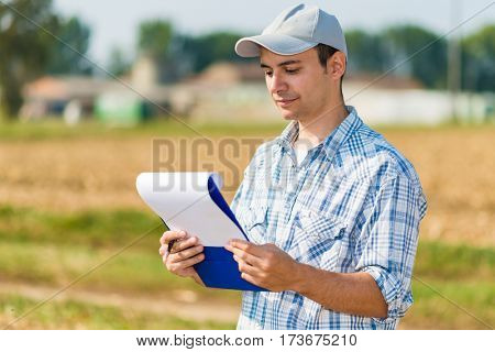 Farmer reading a document