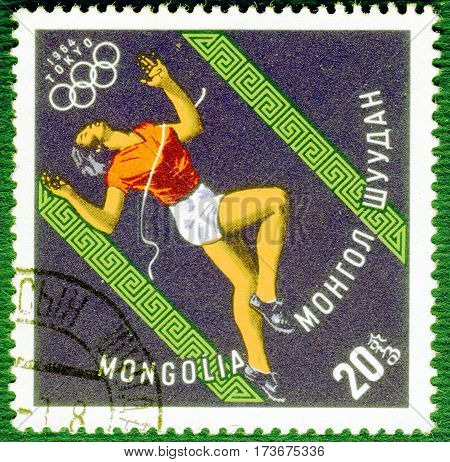 MONGOLIA - CIRCA 1964: Postage stamp printed in Mongolia with a picture of a athlete runner, with the inscription