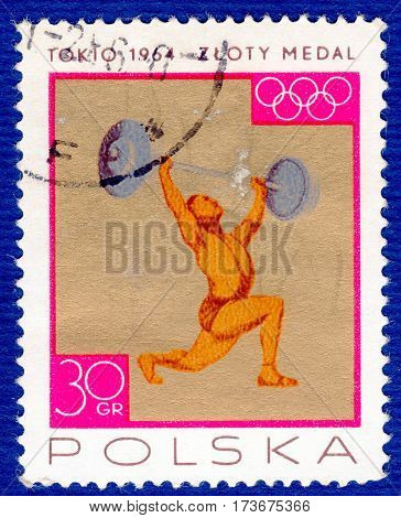 POLAND - CIRCA 1964: Postage stamp printed in Poland with a picture of a weightlifting, with the inscription