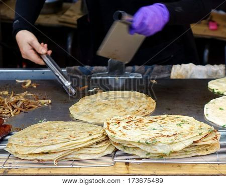 Chinese Street Vendor Cooks Onion Pancakes