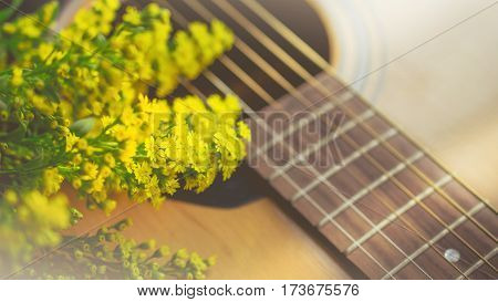 Morning relaxation and cozy with small yellow flower on guitar in vintage tone for Rural vacation lifestyle music therapy concept