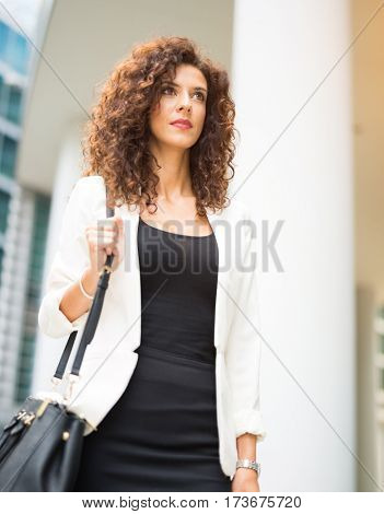 Woman walking in a business district