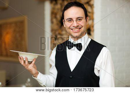 Smiling waiter portrait