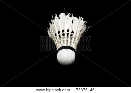 Bad condition badminton ball isolated on black background