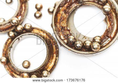 broken ball bearing on isolated white background
