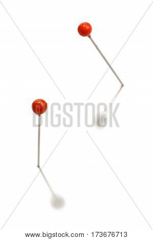 pins with red head on a white background