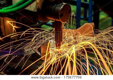 Industrial, automotive spot welding, in a car factory with sparks, manufacturing, industry, factory