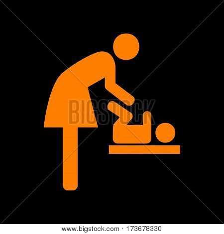 Symbol for women and baby, baby changing. Orange icon on black background. Old phosphor monitor. CRT.