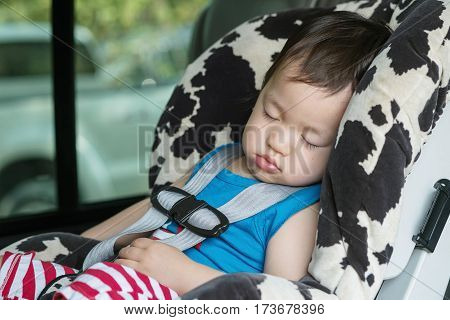 Closeup cute asian kid sleep in car seat in van