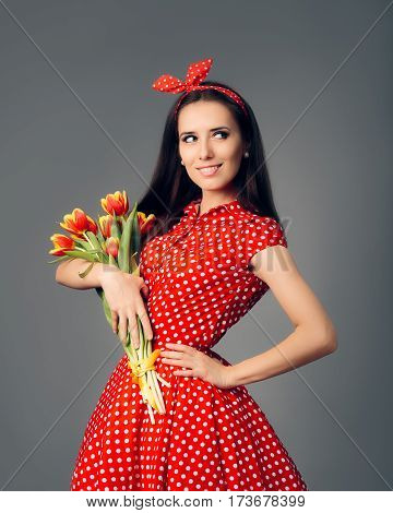 Cute Girl in Retro Red Polka Dress with Tulips